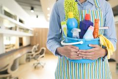 Woman with cleaning equipment ready to clean house Stock Images
