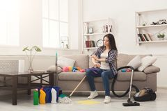 Woman with cleaning equipment ready to clean room Stock Photography