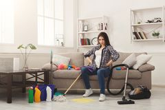 Woman with cleaning equipment ready to clean room Royalty Free Stock Photo