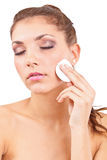 Woman cleaning face Royalty Free Stock Photos