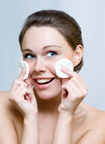Woman cleaning face by cotton pad Royalty Free Stock Images