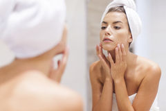 Woman cleaning face Stock Photos