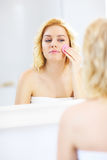 Woman cleaning face Royalty Free Stock Photo