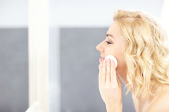Woman cleaning face Stock Image