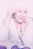 Woman cleaning face Royalty Free Stock Image