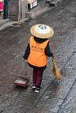 A woman cleaning at Fenghuang Ancient Town in Hunan, China Stock Photos