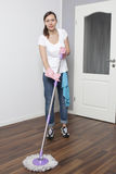 Woman cleaning the flat Royalty Free Stock Images
