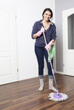 Woman cleaning the flat Stock Photos