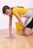 Woman cleaning floor Royalty Free Stock Photos