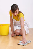 Woman cleaning floor Stock Image