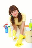 A woman cleaning floor. With sponge and household chemistry isolated on a white background royalty free stock photo