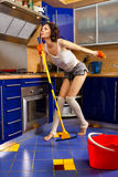 Woman cleaning the floor stock image