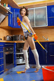 Woman cleaning the floor. Smiling young woman cleaning the floor at home and singing Royalty Free Stock Photos