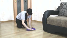 Woman cleaning the floor with a cloth stock video