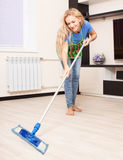 Woman cleaning the floor Royalty Free Stock Images