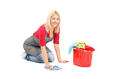 Woman cleaning the floor Stock Photos