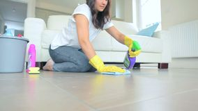 Woman cleaning a floor living room stock footage