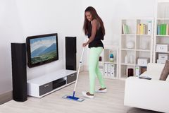 Woman Cleaning Floor In Living Room Royalty Free Stock Photography