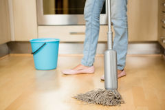 Woman cleaning the floor with mop Royalty Free Stock Photography