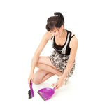 Woman cleaning floor, with sweep brush and dustpan Stock Photography