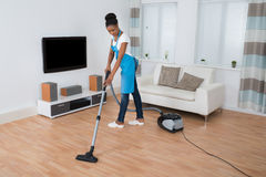 Woman Cleaning Floor With Vacuum Cleaner Stock Photos