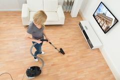 Woman Cleaning Floor With Vacuum Cleaner Royalty Free Stock Photos