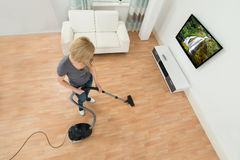 Woman Cleaning Floor With Vacuum Cleaner Royalty Free Stock Images