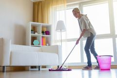 Woman cleaning floors at home royalty free stock photo