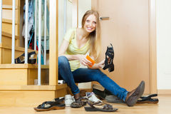 Woman cleaning footwear Royalty Free Stock Photography