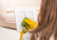 Woman cleaning frame Royalty Free Stock Photo
