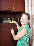 Woman cleaning furniture  cabinet Royalty Free Stock Photos