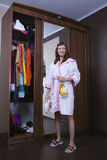Woman cleaning furniture cabinet Stock Image