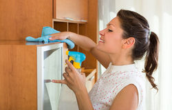 Woman cleaning furniture at home Stock Photo