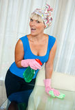Woman cleaning glass table Royalty Free Stock Photos