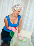Woman cleaning glass table Stock Photos
