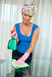 Woman cleaning glass table Stock Images