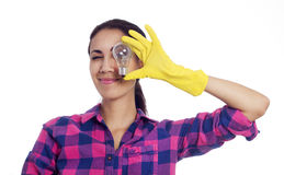 Woman in cleaning gloves with light bulb Stock Images