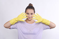 Woman with cleaning gloves Stock Images