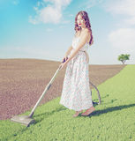 Woman cleaning  grass Royalty Free Stock Photo