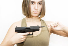Woman cleaning a gun Royalty Free Stock Photography