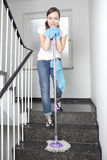 Woman cleaning the hall Stock Images