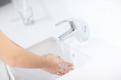 Woman cleaning hands Royalty Free Stock Image