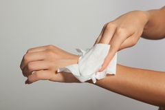Cleaning hands with wet wipes. Woman cleaning hands with wet wipes royalty free stock photography