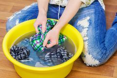 Woman cleaning her blouse with sticky roller Stock Image