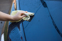 woman cleaning her car using microfiber cloth Royalty Free Stock Photo