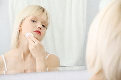 Woman cleaning her face Stock Photo