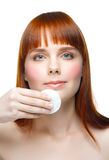 Woman cleaning her face Stock Image