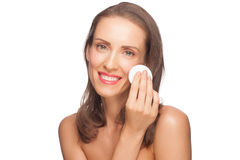 Woman cleaning her face Stock Images