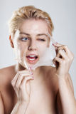 Woman cleaning her face Stock Photos