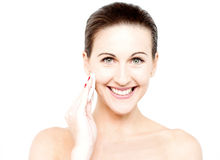 Woman cleaning her face with cotton pad Stock Photography
